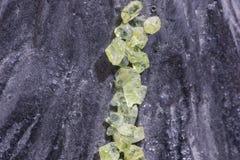 Olivine, green precious stone Stock Image