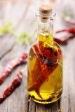 Olivolja med kryddan och örter Royaltyfria Foton