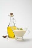 Olivoljasåser och gräddostsås Royaltyfria Bilder