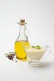 Olivoljasåser och gräddostsås Arkivfoto