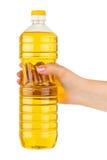 olja för flaskmatlagninghand arkivbild