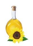 Olja i den isolerade flaskan och solrosen royaltyfria foton