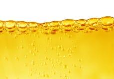 Olja med luftbubblor på viten Arkivfoto