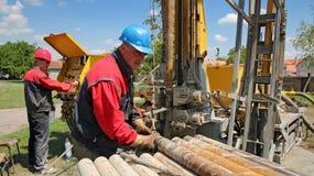 Olje- arbetare på arbete Arkivfoto