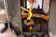 Olje- lampa för att tända rökelsepinnar Fotografering för Bildbyråer