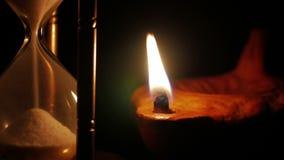 Olje- lampa för timglas och för lera arkivfilmer