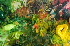Olje- målarfärger på paletten Abstrakt målningbakgrund Arkivbild