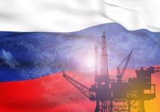 Olje- pump på bakgrund av flaggan av Ryssland Royaltyfria Foton