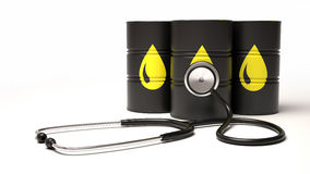 Olje- trummor och stethescope på vit bakgrund Hålla pulsen av oljan Fotografering för Bildbyråer