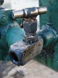 Olje- vattenkran Royaltyfria Bilder