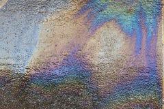 Oljeutsläpp på asfalt Arkivbilder