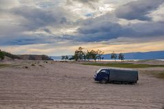 Truck stuck in the sand. Stock Photos