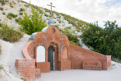 Olkhovka, Russia - July 10, 2016: Entrance to the cave monastery of Holy Trinity Stone-Brodsky Monastery in olkhovsky district of Royalty Free Stock Photography