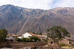 Ollantaytambo - Church and Ancillary Buildings. Church and Ancillary Buildings with the Andes in the background Royalty Free Stock Photos