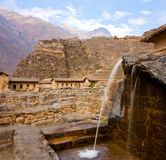 Ollantaytambo - a Fountain. A fountain, part of the Inca domestic water supply, Inca ruins in the background Stock Images