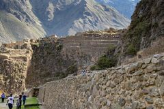 The Ollantaytambo Inca Archaeological Site. In the Sacred Valley Located in Southern Peru Featuring Grain Storage Buildings on the e of the Mountain royalty free stock image