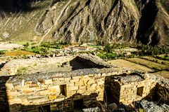 Ollantaytambo - old Inca fortress and town the hills of the Sacred Valley (Valle Sagrado) in the Andes mountains of Peru, South Am Stock Image