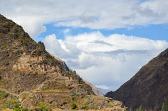 OLLANTAYTAMBO, PERU- JUNE 3, 2013: Inca storehouses on the hill surrounding Ollantaytambo royalty free stock photos