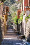 Ollantaytambo, Urubamba/Peru - circa June 2015: Old narrow street and brick buildings in Ollantaytambo Inca  town Stock Photo
