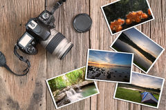 Olld grunge camera and photos on vintage grunge wooden background Stock Photos