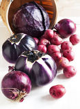 Сollection of fresh purple toned vegetables. Stock Images