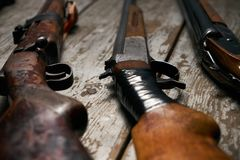 Ollection of hunting rifles. Rifles, shotguns on wooden table background, Hunting guns close-up Stock Image