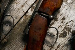 Ollection of hunting rifles. Rifles, shotguns on wooden table background, Hunting guns close-up Royalty Free Stock Photos