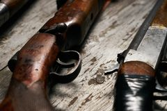 Ollection of hunting rifles. Rifles, shotguns on wooden table background, Hunting guns close-up Stock Images