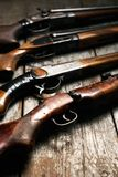 Ollection of hunting rifles. Rifles, shotguns on wooden table background, Hunting guns close-up Stock Photography