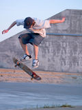 Ollie - Young skater ollieing a skateboard Royalty Free Stock Photos