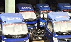 Ollin light trucks warehouse Stock Images