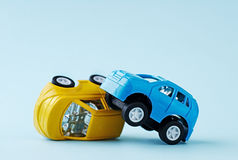 Сollision of two toy cars on a blue background Stock Images