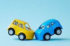 Сollision of two toy cars on a blue background Royalty Free Stock Photography