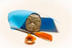 Olmec Head Rock Paper Scissors. Olmec Rock Crushes Scissors, scissors cut paper, paper covers rock Royalty Free Stock Images