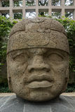 Olmec stone head. Huge magestic Olcem culture ancient sculpture head. Mexican prehispanic era in the territory of Veracruz. Ancient Mexican civilization icon Royalty Free Stock Photography