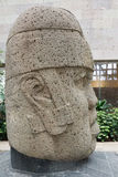 Olmec stone head. Huge magestic Olcem culture ancient sculpture head. Mexican prehispanic era in the territory of Veracruz. Ancient Mexican civilization icon Stock Image