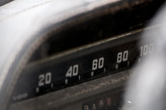 Vintage car dashboard. Detail of an old car dashboard with tachometer numbers Stock Photos
