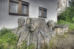 Olomouc city in Czech Republic - socialism heads. In ugly background stock photography