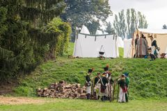 Olomouc Czech Rep. October 7th 2017 historical festival Olmutz 1813. Napoleonic soldiers talk together and relaxing by. Firewood in a military camp Stock Image
