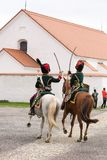 Olomouc Czech Rep. October 7th 2017 historical festival Olmutz 1813. Two napoleonic officers riding horses and fighting. Sabers with a church in background Royalty Free Stock Photos