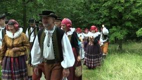 Olomouc, Czech Republic, April 15, 2018: Crowd pilgrimage of people cross way in the traditional folk costume of Hana stock video footage