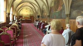 OLOMOUC, CZECH REPUBLIC, APRIL 15, 2018: Knight`s Hall in the town city hall of Olomouc, old people retirees sitting on stock video footage
