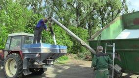 OLOMOUC, CZECH REPUBLIC, APRIL 27, 2018: Modern large fertilizer spreader. Sprinkling tank fertilizers NPK nitrogen. Modern large fertilizer spreader. Sprinkling stock video footage