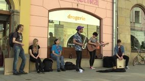 OLOMOUC, CZECH REPUBLIC, APRIL 12, 2018: Street music busking band group playing on saxophone, guitar and drum, begging stock video footage