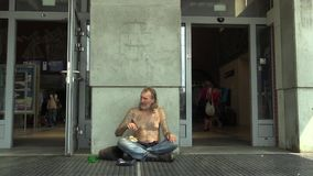 OLOMOUC, CZECH REPUBLIC AUGUST 27, 2015: Authentic emotion man poor homeless in city begging stock footage