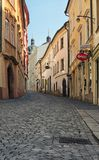 OLOMOUC, CZECH REPUBLIC-AUGUST 27, 2017: A narrow and winding street in the old town of Olomouc. Czech Republic. Summer morning vi Royalty Free Stock Photos