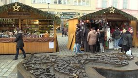 OLOMOUC, CZECH REPUBLIC, DECEMBER 17, 2017: People at the Christmas advent market stall at the square, herbal teas, knit. People at the Christmas advent market stock footage