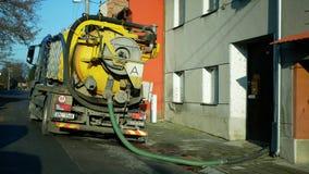 OLOMOUC, CZECH REPUBLIC, DECEMBER, 30, 2019: Septic cesspool emptying pumping into pipe tank truck suction hose under