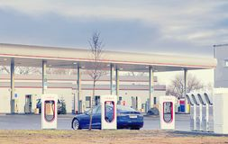 Olomouc Czech Republic December 31st 2017 - Tesla model S car being charged at Tesla charging station with gas station stock photography