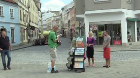 OLOMOUC, CZECH REPUBLIC, JULY 5, 2018: Jehovahs Witnesses religious society, two young women on the street offer books